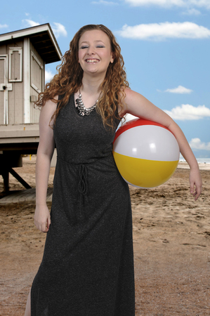 Beautiful young woman holding a beach ball Stock Photo