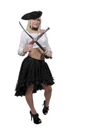 Young beautiful pirate woman with a flintlock pistol and sword Stock Photo