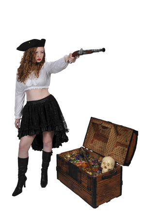 Young beautiful pirate woman with a flintlock pistol Stock Photo