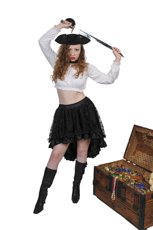 Beautiful young woman pirate opening a treasure chest Stock Photo