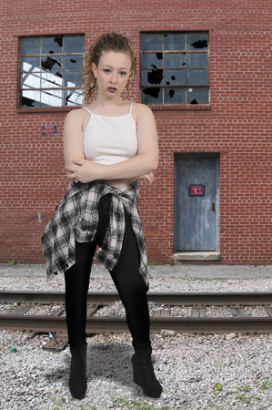 Young beautiful woman hipster standing around being cool