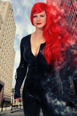 Beautiful woman wearing a black vinyl rubber latex cat suit Stock Photo