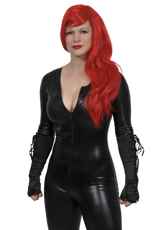 Beautiful woman wearing a black vinyl rubber latex cat suit Stock Photo - 91229680