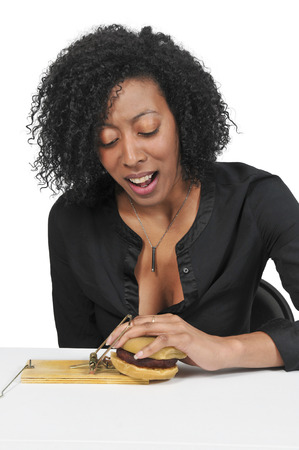 Beautiful woman using the mouse trap diet plan Stock Photo