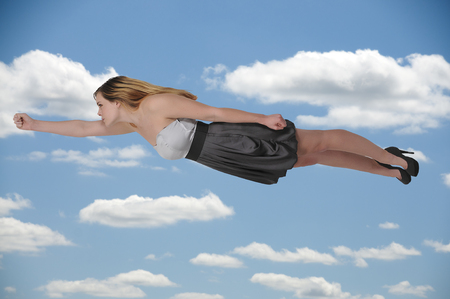 Beautiful young woman flying through the sky