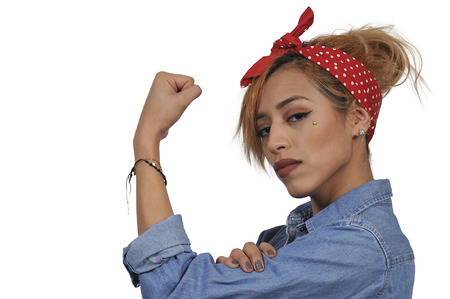 Beautiful woman dressed as the iconic Rosie the Riveter