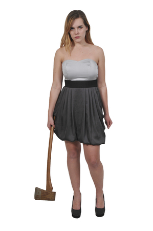 Beautiful young woman holding an wooden handled axe 스톡 콘텐츠