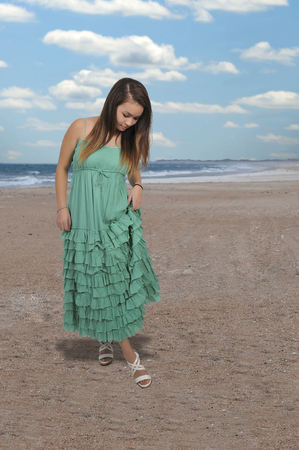 Beautiful young attractive woman modeling her dress Stock Photo