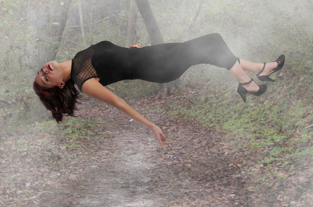 Beautiful young woman floating in the air