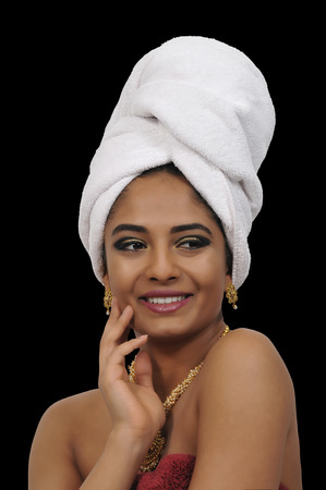 Beautiful woman wearing a towel in her hair