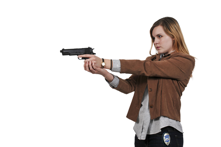 Beautiful police detective woman on the job with a gun