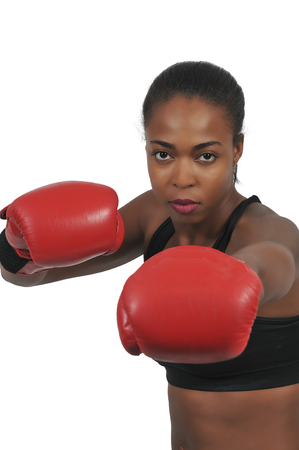 Beautiful young black woman wearing a pair of boxing gloves