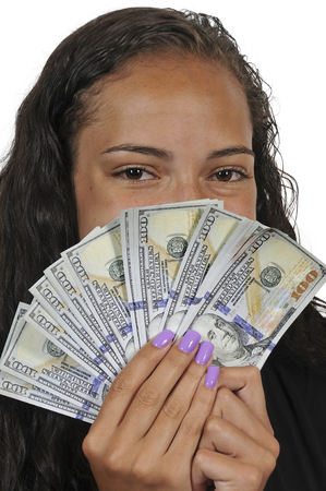Black African American woman holding a hand full of 100 dollar bills