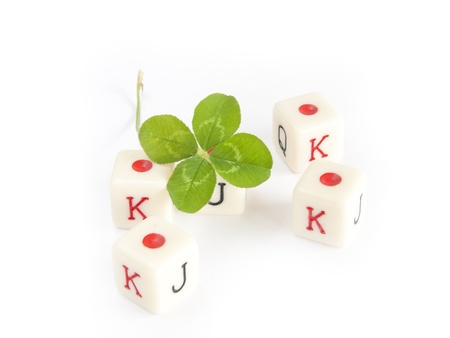 dice game with four leaf clover on white background photo