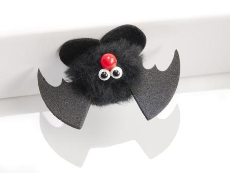 stuffed animal shaped bat on white background Stock Photo