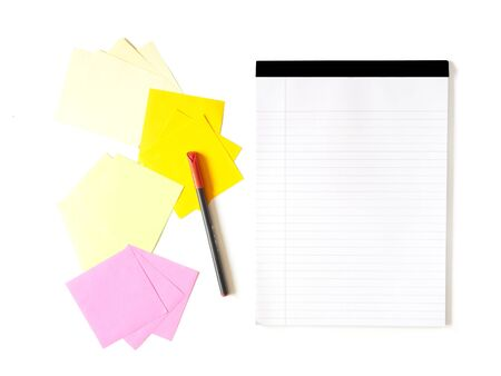 notes folder with colored paper and pen on white background photo