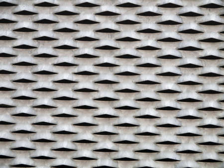 metal grid pattern with holes photo