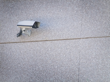 security cameras attached on the office building corner  photo