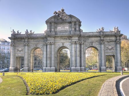 Madrid Puerta de Alcala with flower gardens in Spain  Editorial