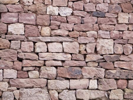 Rustic wall of stones of different sizes Stock Photo - 16959679