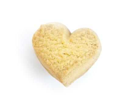 cupido: galletas en forma de coraz�n sobre fondo blanco