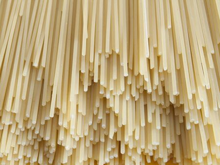Uncooked pasta spaghetti macaroni isolated   photo