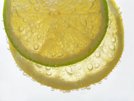 lemon an lime with bubbles isolated on white