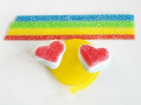 Heart-shaped candy on white background photo