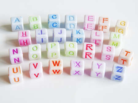 Image of various colorful blocks with the alphabet isolated on a white background   photo