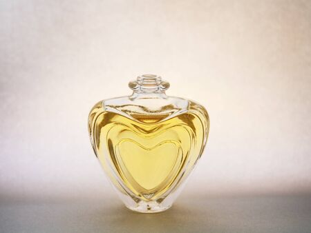 perfume bottle with heart shape Stock Photo