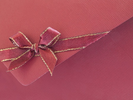 Red paper envelope with bow photo