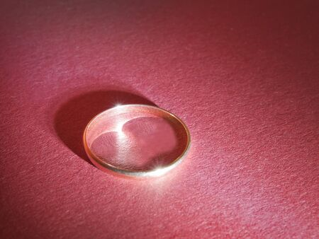 gold ring on red paper background abstract abstract