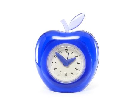 blue clock shaped apple on white background