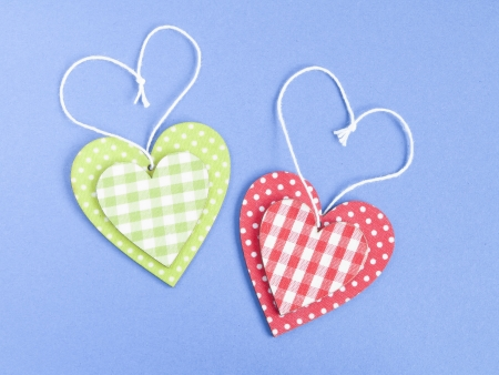 Funny wooden hearts on blue background photo