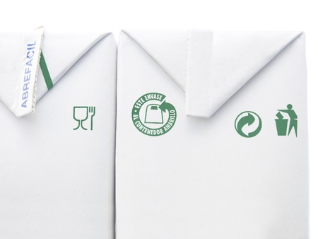 recycling symbolen op melkpak Stockfoto