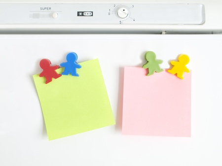 magnets shaped kids colors with note paper Stock Photo