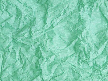 Background from green paper texture photo