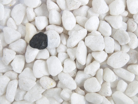 white marble stones with black stone photo