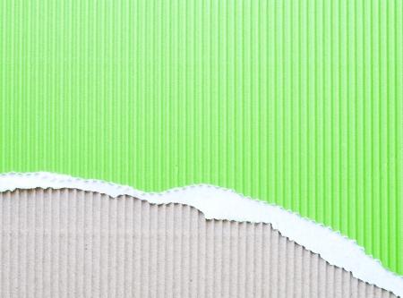 torn corrugated cardboard recycling green photo