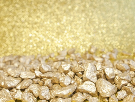 golden stones and gold abstract background with blurred