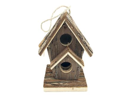 cortado: casa del pájaro en el fondo blanco