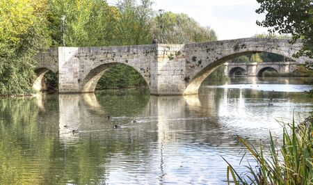 medieval bridge over the river Carrion in Palencia, Spain