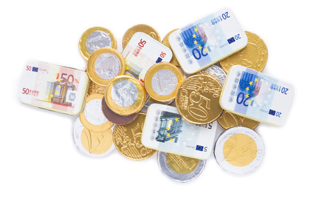 Gold coins of one euro, on a white background photo