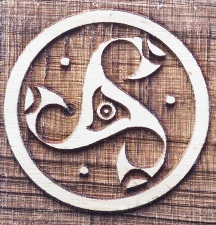 Former Celtic triskele symbol carved wooden circle