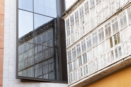 windows in modern and ancient city contrast Burgos, Spain
