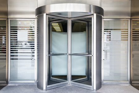 steel building: revolving door of modern building Stock Photo