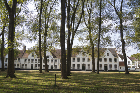 White houses in the Beguinage (Begijnhof) in Bruges, Belgium