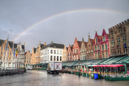 BRUGES, BELGIUM - SEPTEMBER 17 2014: the market square in Bruges, Belgium on september 17 , 2014. The historic city centre of Bruges is a prominent World Heritage Site of UNESCO Editorial
