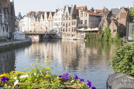 gabled houses: GHENT, BELGIUM - SEPTEMBER 18, 2014: View of historical center of Gent with picturesque medieval gabled houses along canal. Ghent is a city and a municipality located in the Flemish region of Belgium. Editorial