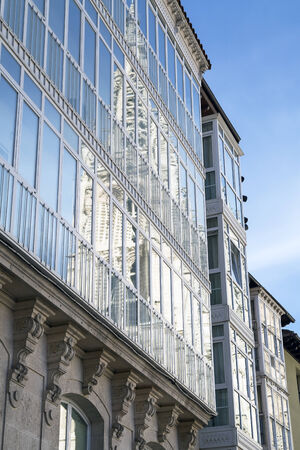 Burgos Cathedral reflected in glass building